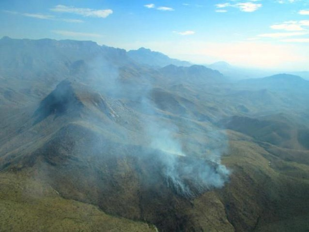 aerial view of smoke in the mountains