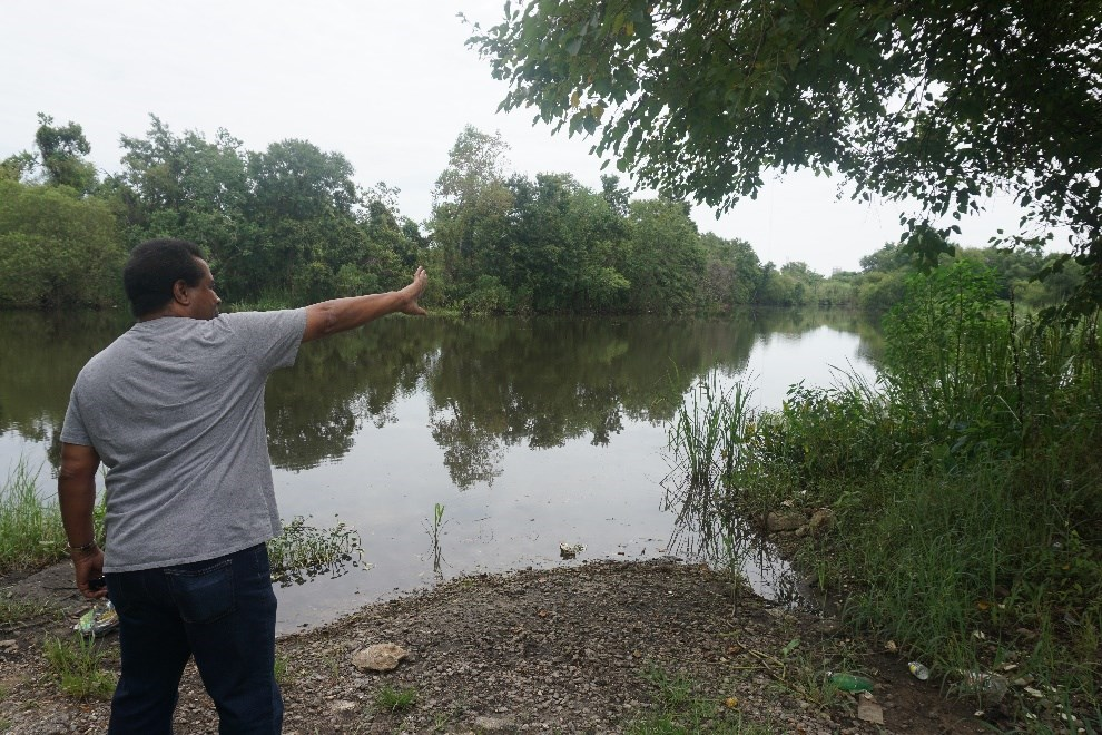 Womack shows where he hopes to see a boat launch by a popular fishing spot along the Chickasaw Creek. Photo by Margaret Gach, National Park Service.