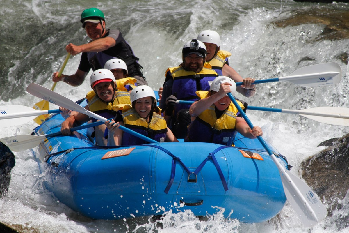 Rafters paddling through whitewater.