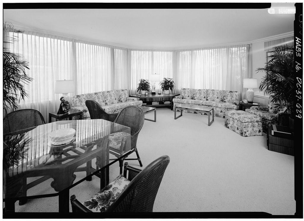 Large room with windows and 1960s furniture