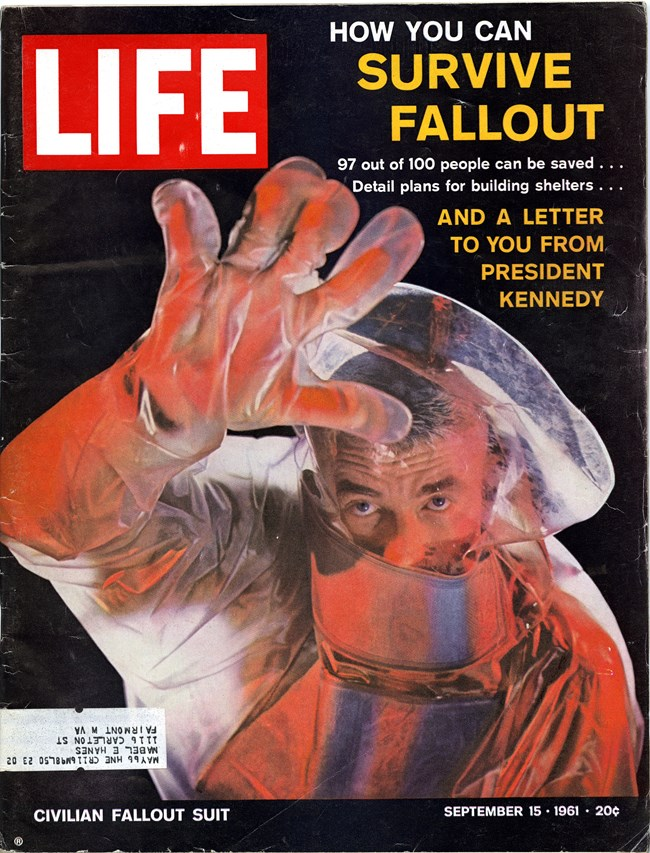 Photograph of a Time Magazine cover showing a man in a radiation suit