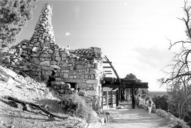 Rugged stone building built on the rim of Grand Canyon.