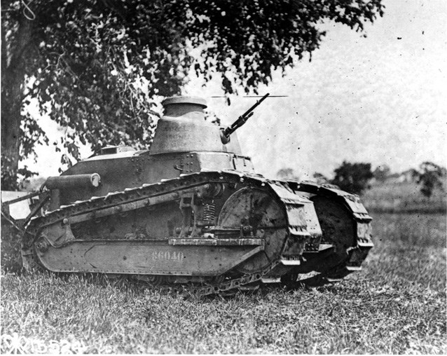 A Renault FT-17 parked under a tree.