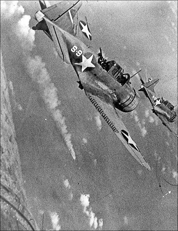 Dive-bombers attacking a Japanese ship, 1942.