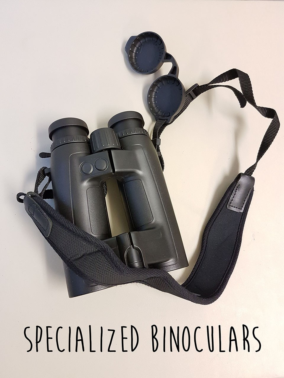 a pair of black binoculars on a white background with text reading Specialized Binoculars laid over top