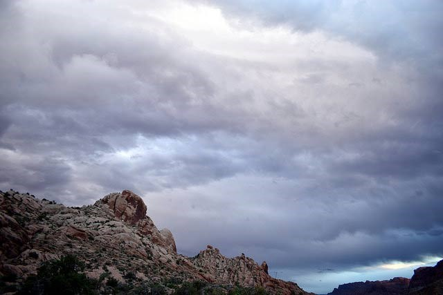 gray storm clouds over red rocks