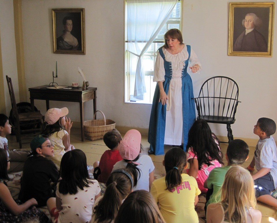 Living historian portraying Abigail Adams to a school group