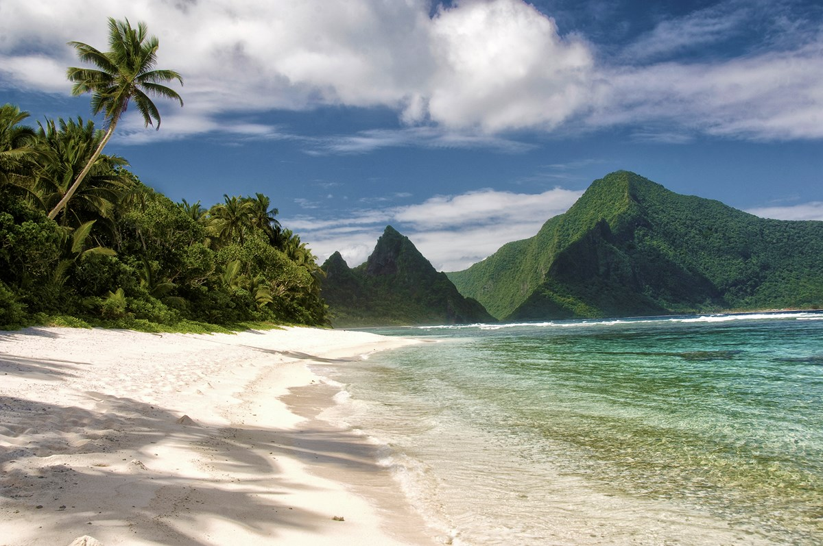 Island beach with mountains in the background