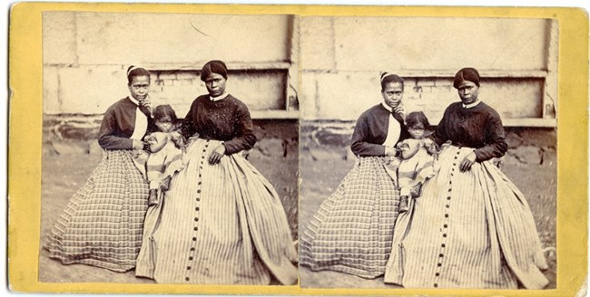 Stereoview of Selina Gray, enslaved servant at Arlington House, and two of her daughters.