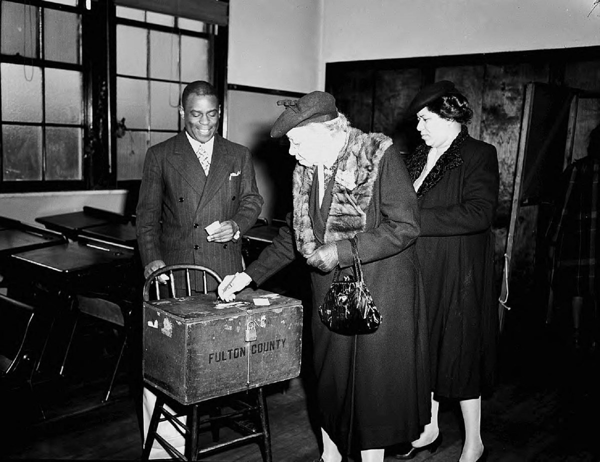Casting ballots in the race for Fifth District, United States Congress. African American voters were crucial to Helen Douglas Mankin's electoral victory. LBME3-037a, Lane Brothers Commercial Photographers Photographic Collection, 1920-1976. Photographic C