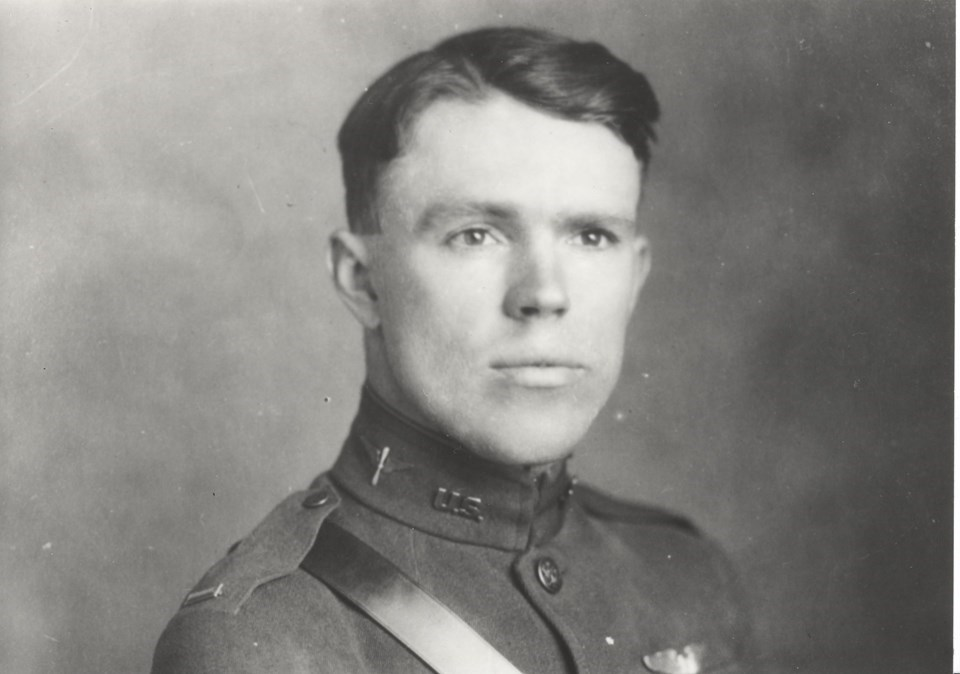 Photo of young man wearing pilot's uniform.