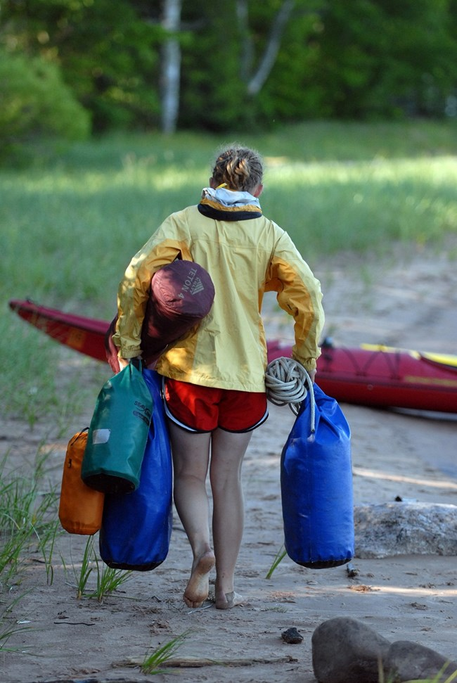 Kayaker packing up after a long day