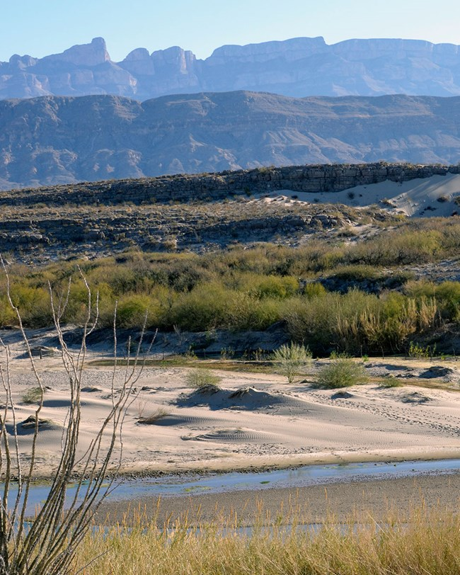 river, dunes, and mountains