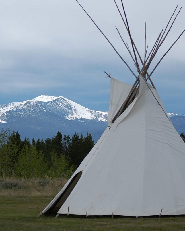 tepee and mountains