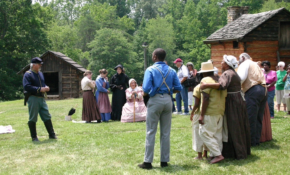 Reeanctors portraying a Union soldier talking to the Washington family