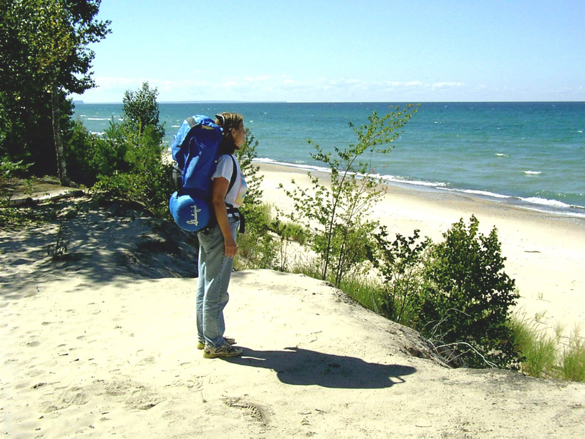 Backpacker standing on Lake Superior Shore