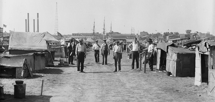 Men stand in the BEF camp.