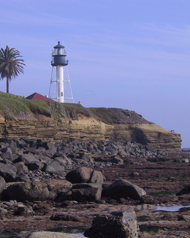 lighthouse and coastal bluff