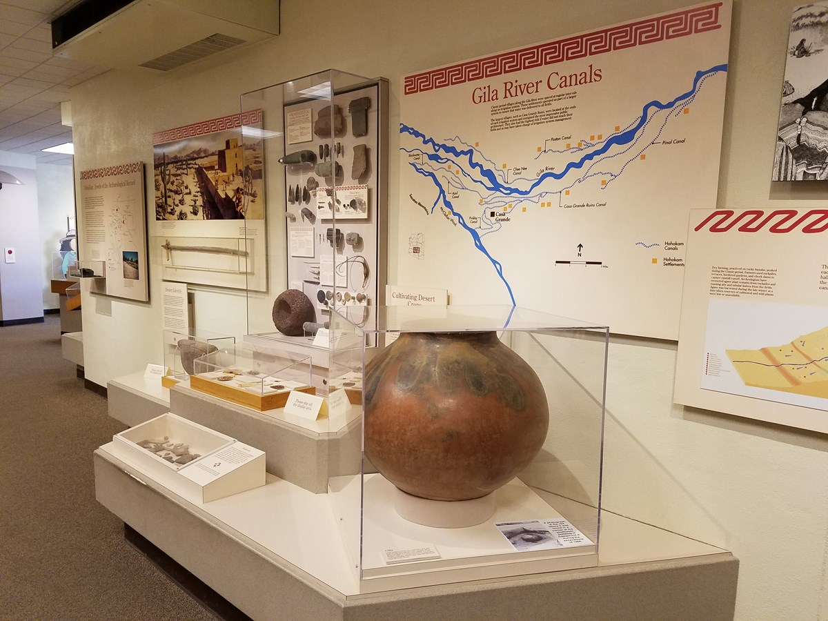 Museum exhibit with about Gila River Canals with signs and pottery pieces