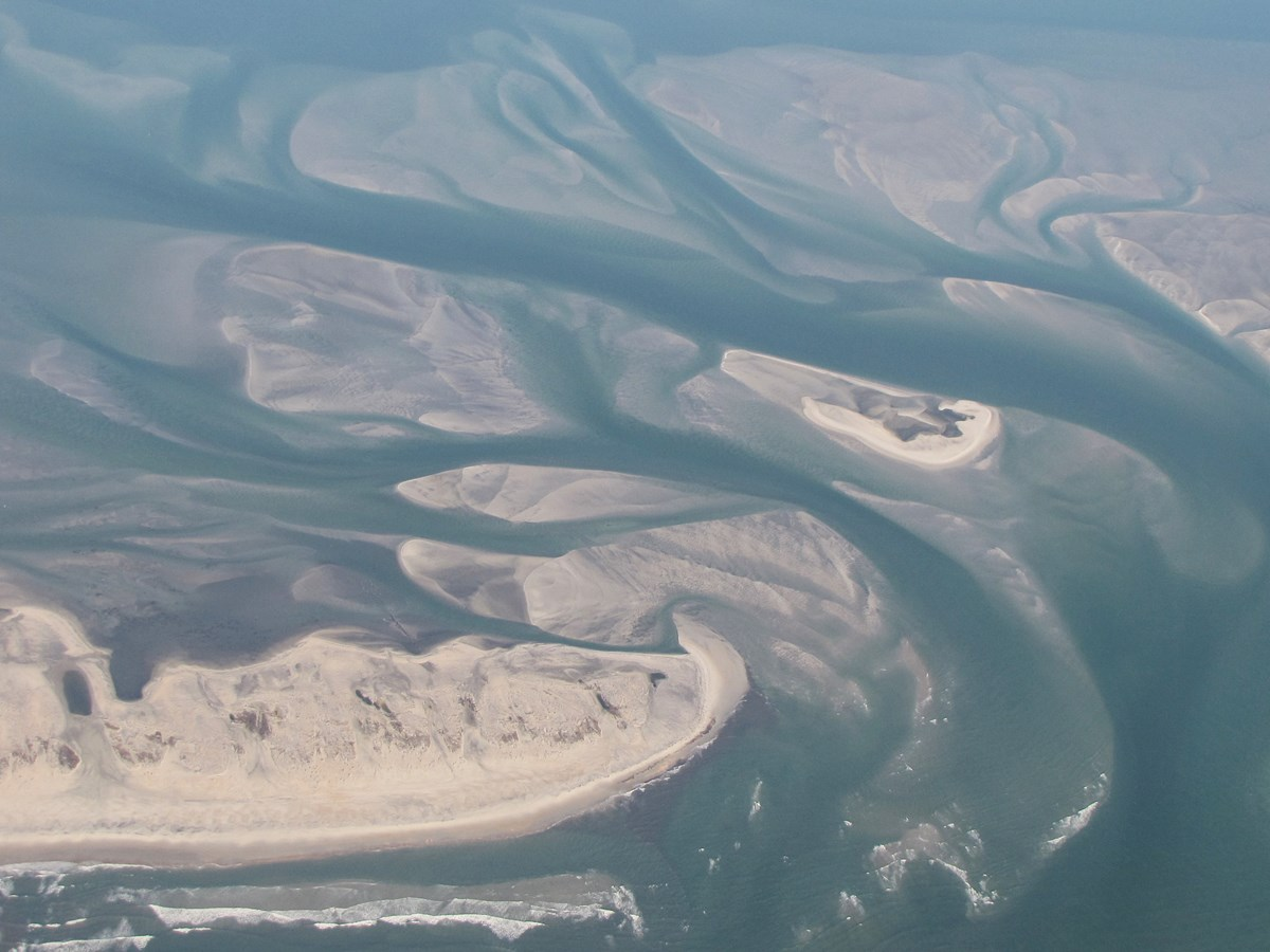 aerial photo of coastal sediment bars and channels