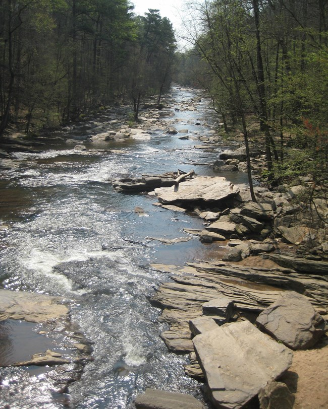 river running through rocky shoals