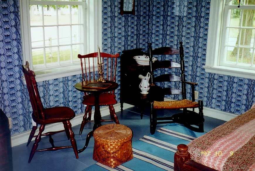 Photo of the inside of a parlor with three wooden chairs. 9Courtesy of the Prudence Crandall Museum, administered by the Connecticut Historical Commission, State of Connecticut)