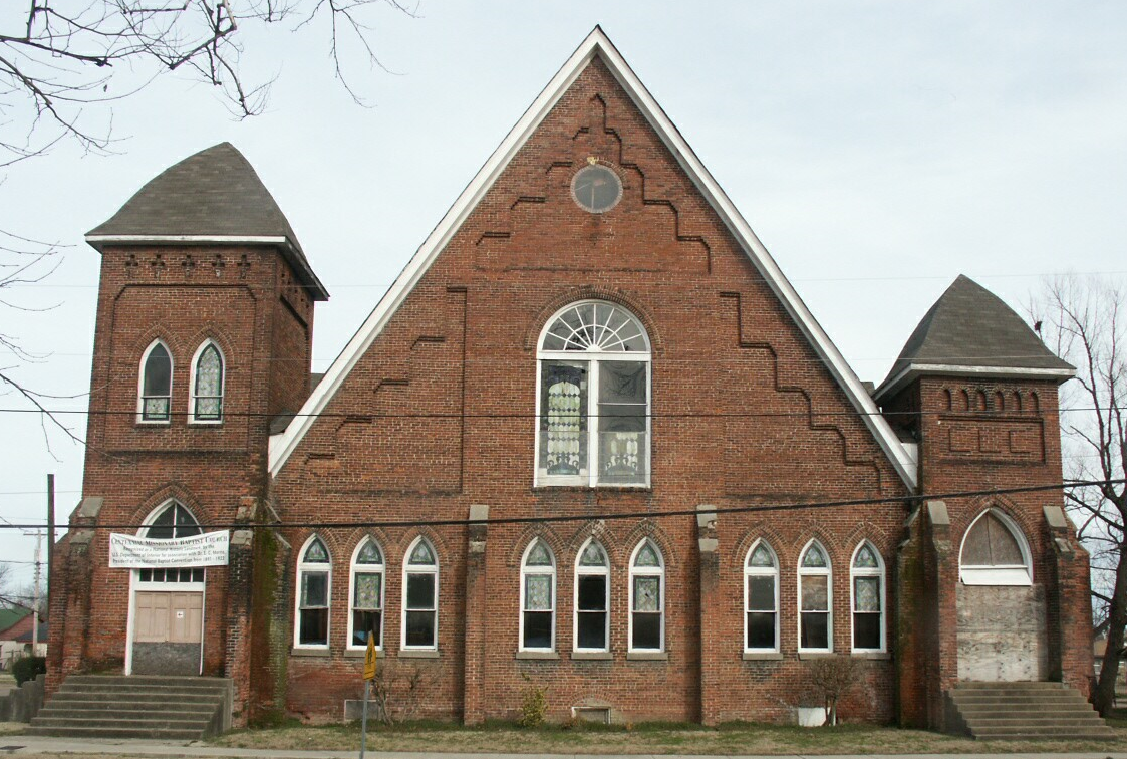 Brick building with arched windows.
