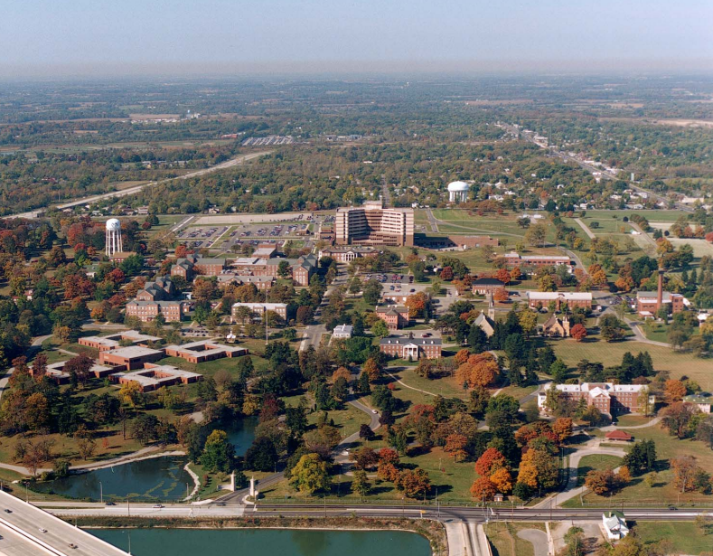 Aerial view of buildings, trees, and lakes.
