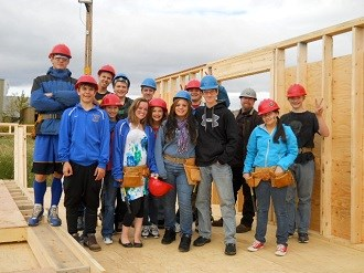 Youth group wearing hard hats
