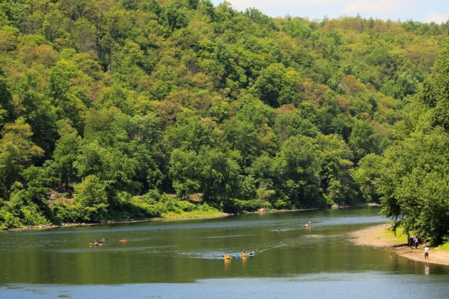 Kayakers enjoy a peaceful paddle down the Middle Delaware National Scenic and Recreational River.