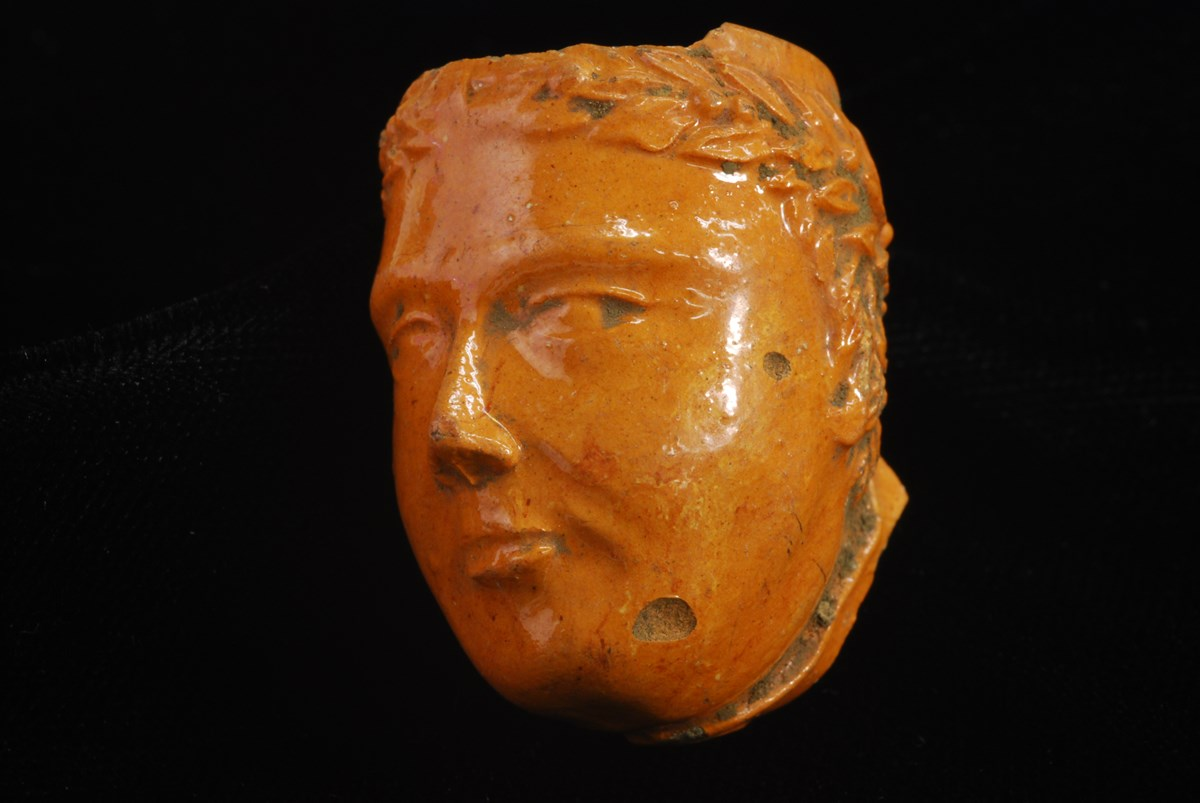 Photo of red clay tobacco pipe bowl molded in the figure of the head of Millard Fillmore