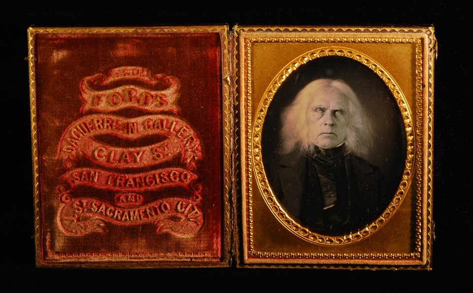 Daguerreotype of white-haired man in case with imprinted velvet interior