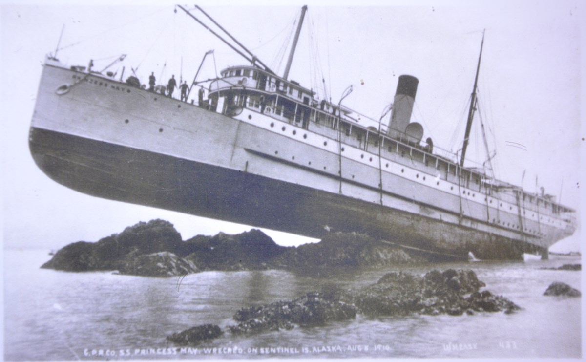 Steamship run aground on jutting rocks