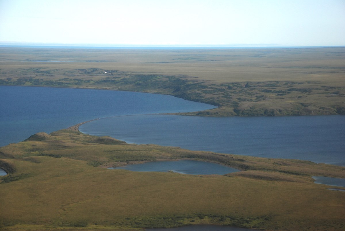 Aerial view of two oval shaped lakes separated by a sand spit