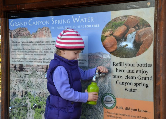 A girl refilling her water bottle at Grand Canyon National Park