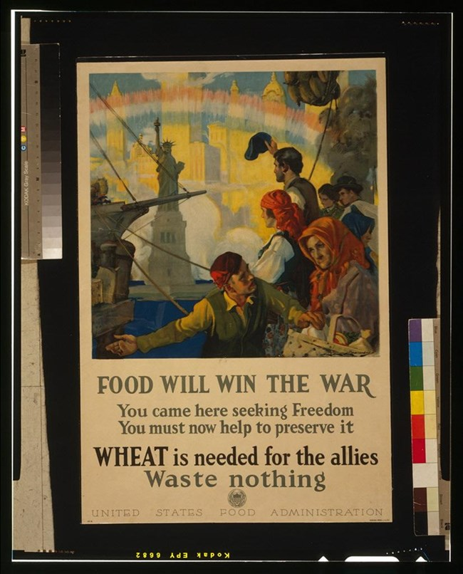 "Cartoon of immigrants in front of the Statue of Liberty, ""Food will win the war"""