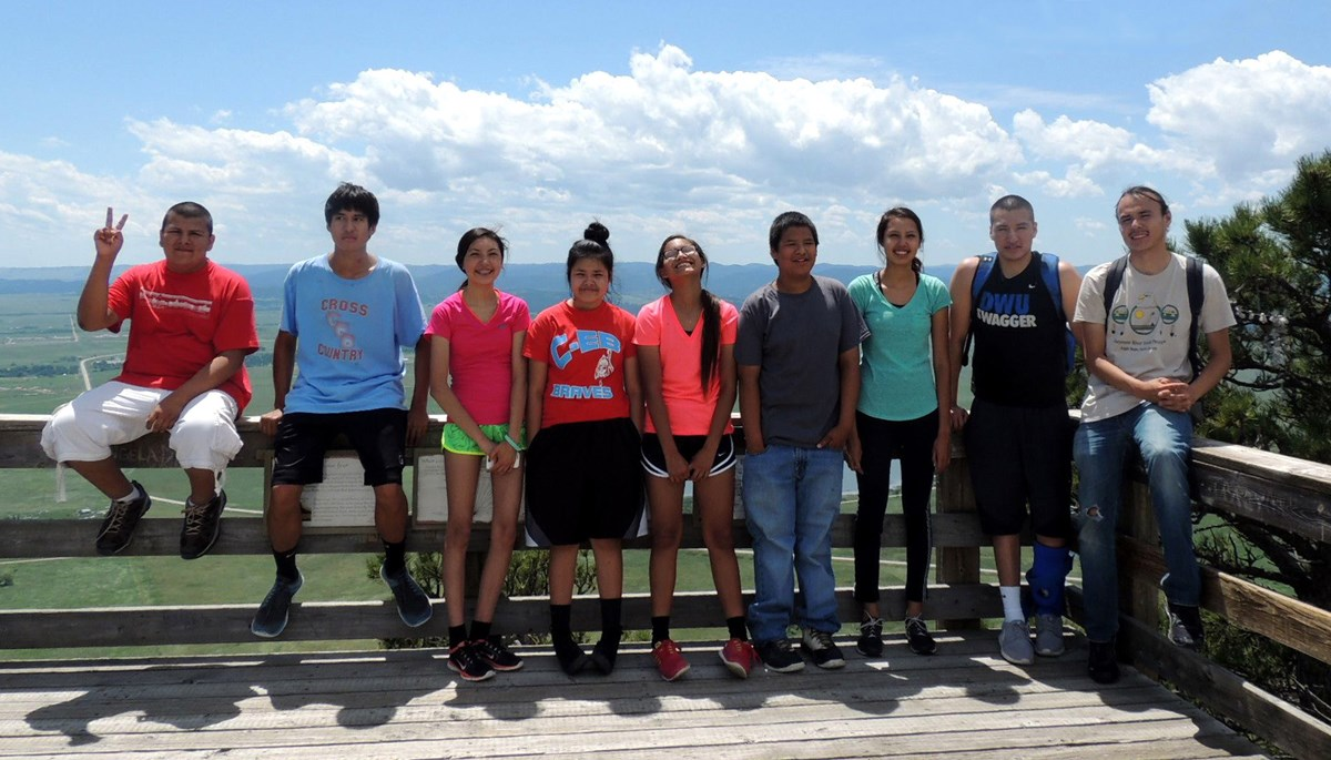 Nine young people standing at an overlook.