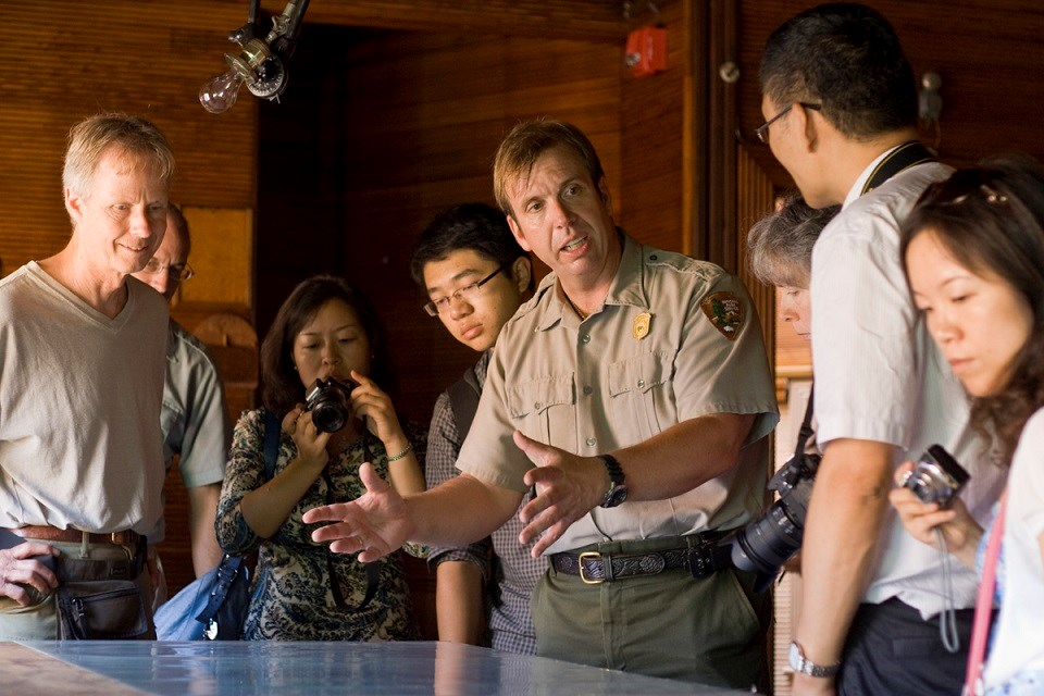 Ranger giving a talk to visitors over a tabletop display