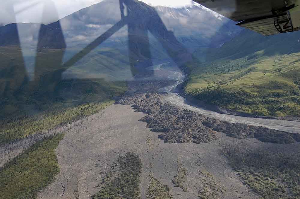 A view from a plane window of a large debris flow.