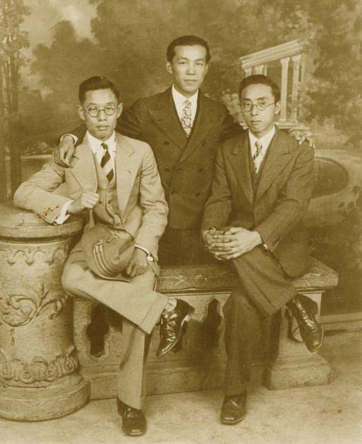Three men pose for a picture