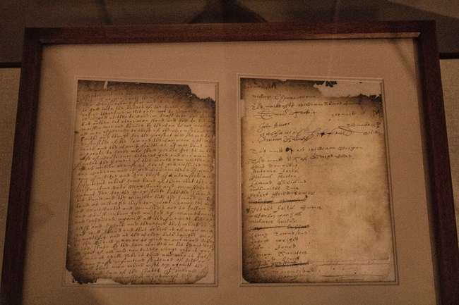 Two slightly charred pages of an old document in old Dutch