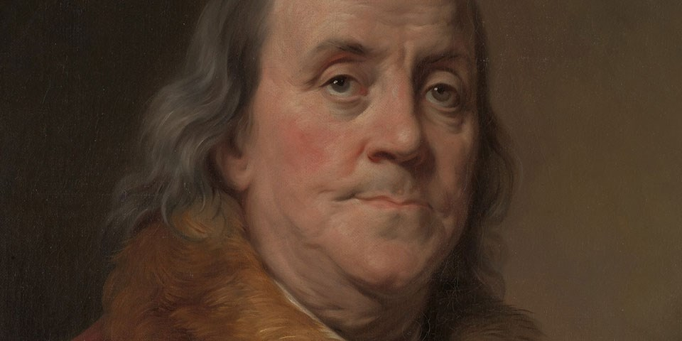 Detail, color portrait of Benjamin Franklin showing an old man with a receding hair line.