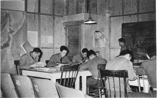 Japanese American men learning at the Military Intelligence Service Language School at the Presidio