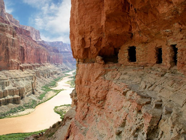 prehistoric granaries in canyon wall above river