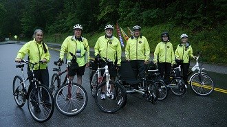 Group of volunteer bicyclists with their bikes