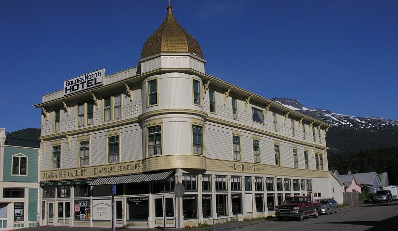 Three story hotel with golden dome