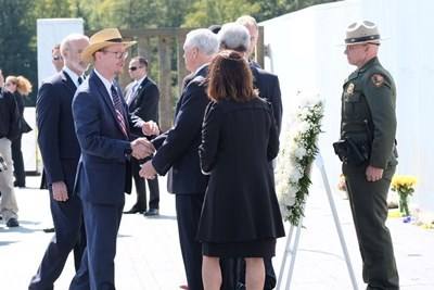 Vice President Pence (right) shaking hands with Gordie Felt (left) during wreath laying ceremony. DOI Photo: Heilemann.