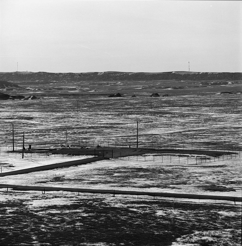 A fenced compound in a prairie landscape