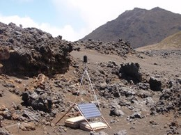 Equipment set up in a dry rocky mountainous area.