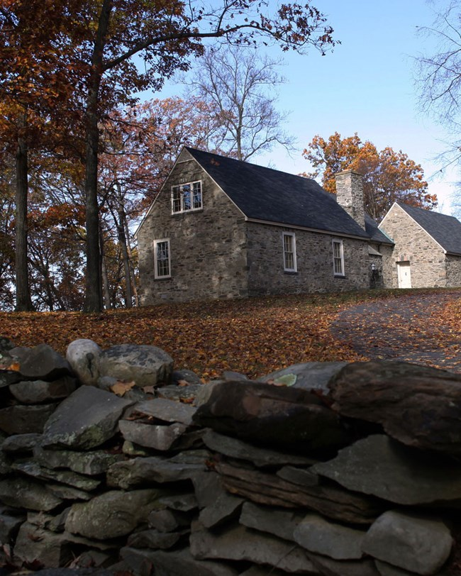 stone wall and cottage